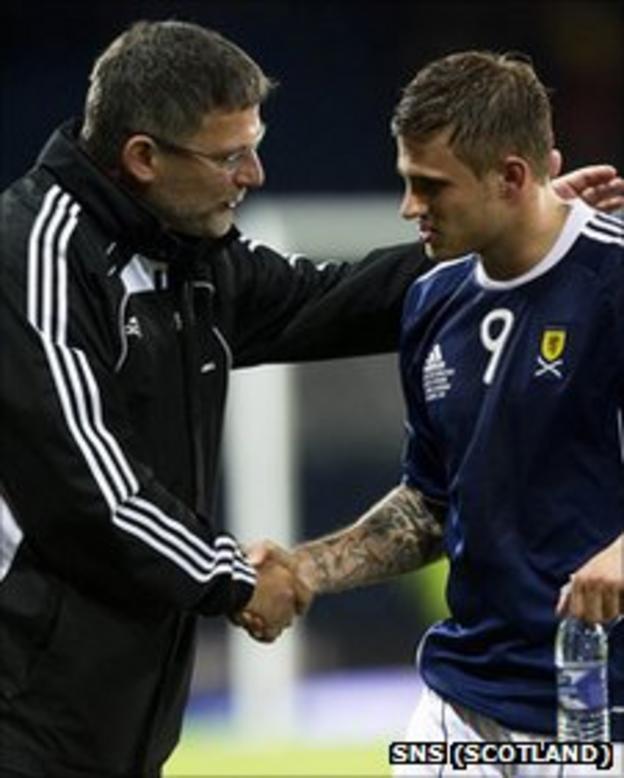 Scotland boss Craig Levein congratulates striker David Goodwillie