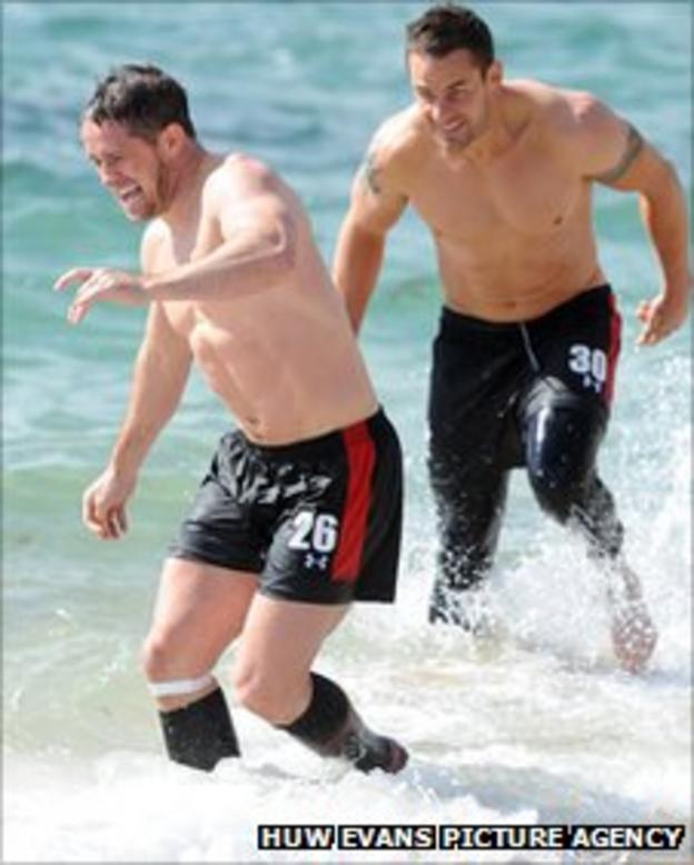 Shane Williams and Lee Byrne enjoy a recovery session in the sea in Wellington