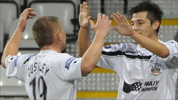 David Cushley congratulates goalscorer Jordan Hughes at Seaview