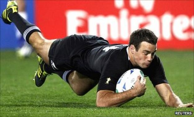 New Zealand winger Richard Kahui dives over for one of his first-half brace against Tonga