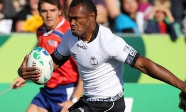 Fiji's Vereniki Goneva steps through the tackle of Namibia's Conrad Marais