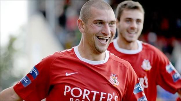 Matthew Tipton celebrates after winning the game for Portadown