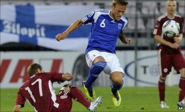 Latvia's Edgars Gauracs (l) challenges Mika Vayrynen of Finland