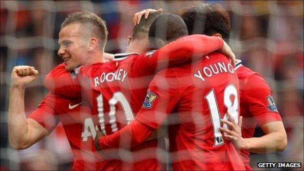 Cleverley, Rooney and Young celebrate