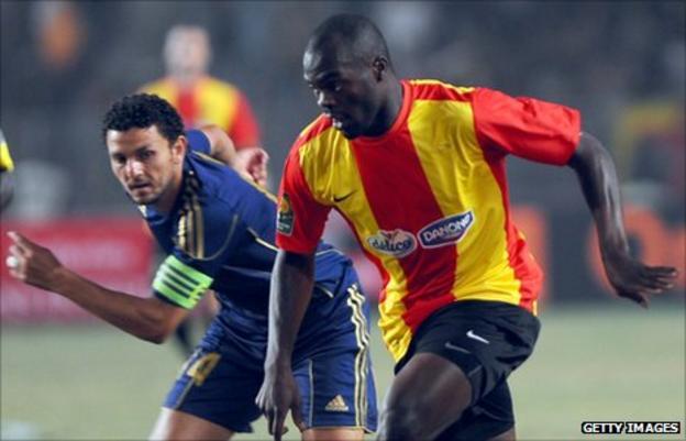 Esperance's Joseph Yannick N'Djeng (right) battles with Al Ahly's Hossam Ghaly