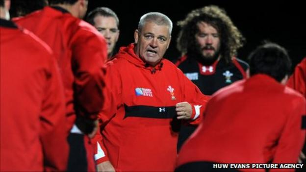 Warren Gatland with Wales players at a training session