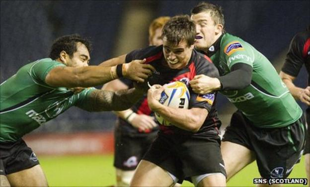 Edinburgh's Lee Jones is tackled by two Connacht players