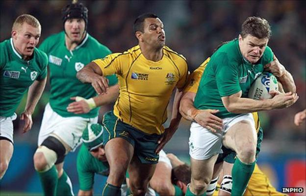 Kurtley Beale of Australia tackles Ireland captain Brian O'Driscoll