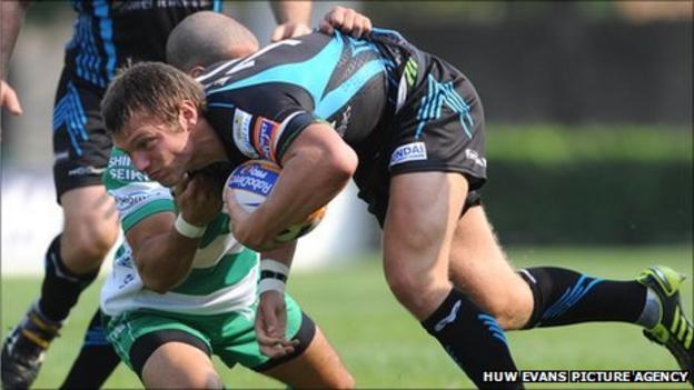 Ospreys fly-half Dan Biggar is tackled by Alberto Chillon of Treviso