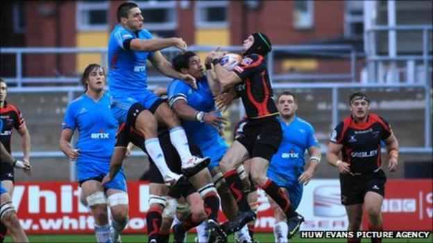 Dragons' Michael Poole outjumps the Aironi defence to claim high ball