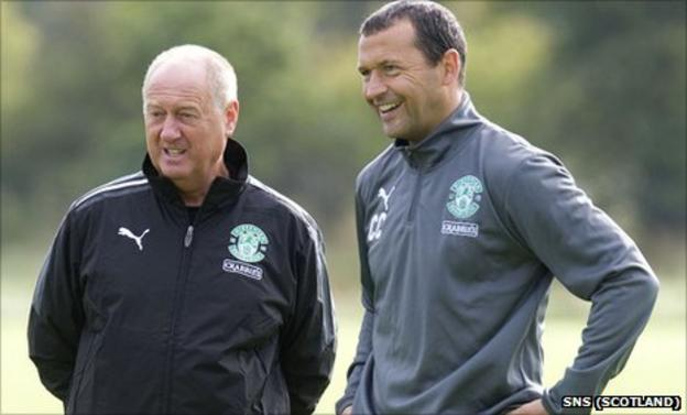 Billy Brown (left) observes training with Hibs manager Colin Calderwood