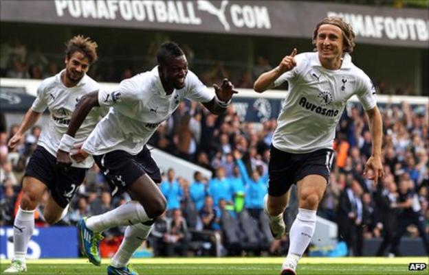 Luka Modric (right) celebrates his goal against Liverpool