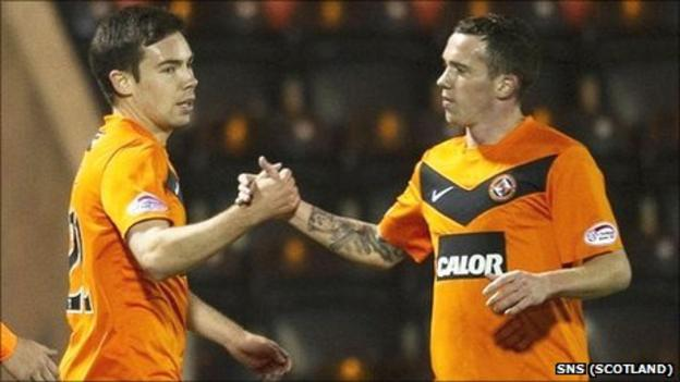 Ryan Dow (l) is congratulated on his goal by Danny Swanson