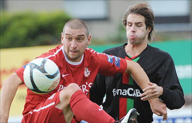 Portadown's Matthew Tipton in action against Sean Ward of Glentoran