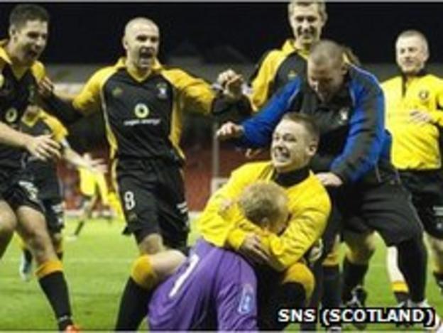 The East Fife players mob keeper Mark Ridgers
