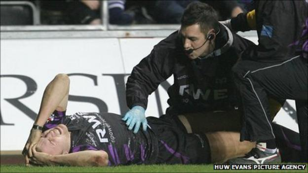 Tom Prydie receives medical attention after being injured playing for Ospreys against Glasgow