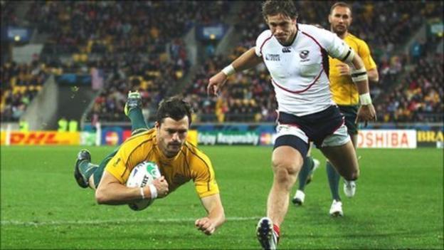 Adam Ashley-Cooper dives over to score Australia's seventh try