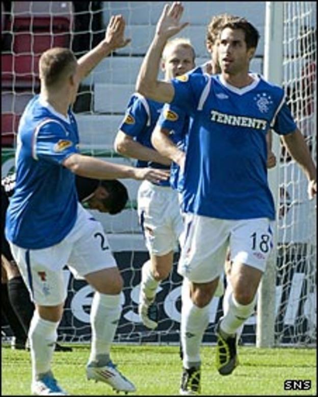 Carlos Bocanegra (right) celebrates