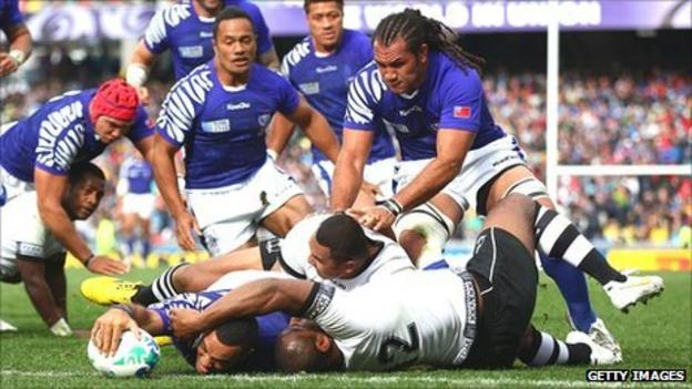 Kahn Fotuali'i of Samoa goes over to score their first try