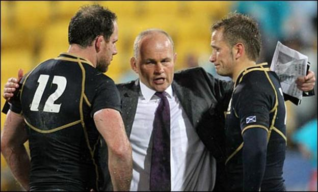 Andy Robinson consoles his players