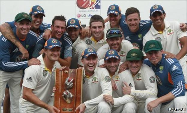 Australia celebrate with the Warne-Muralitharan Trophy after winning the Test series