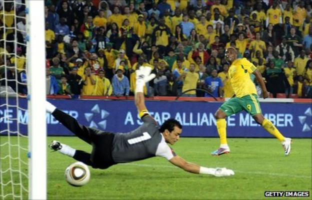 South Africa's Katlego Mphela scores against Egypt in a Nations Cup qualifier in 2011