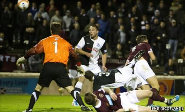 Eggert Jonsson sends the ball into the net