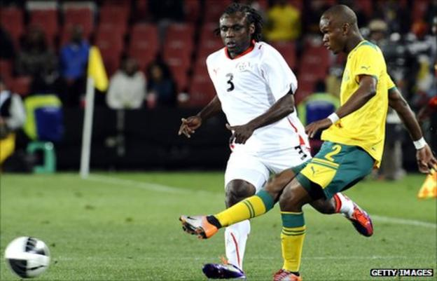 Herve Zengue (in white) and Siboniso Gaxa of South Africa