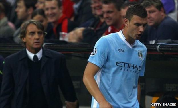 Edin Dzeko reacts angrily after being substituted
