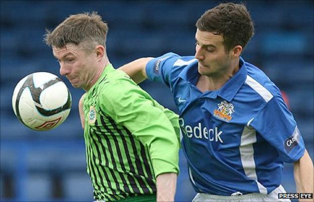 Paul McVeigh of Donegal Celtic in action against Glenavon's Mark Turkington