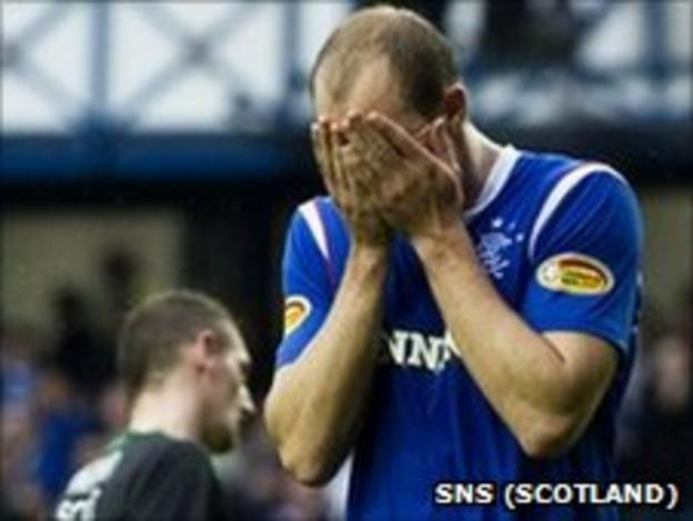 Steven Whittaker holds his head in his hands after missing a penalty for Rangers against Hibernian