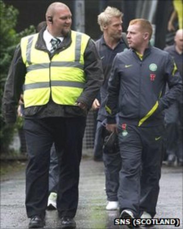A minder keeps an eye on Celtic boss Neil Lennon at Tynecastle