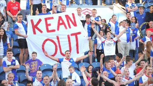 Blackburn fans protest against Kean after the 4-0 loss to Manchester City
