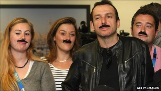 French media sport moustaches in support of coach Marc Lievremont