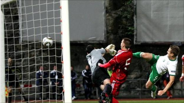 Kevin Doyle leaps to fire in the opener for the Republic in Andorra