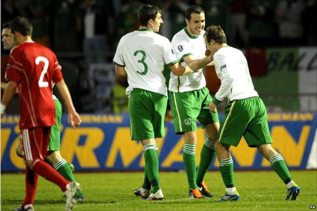 Republic of Ireland players celebrate.