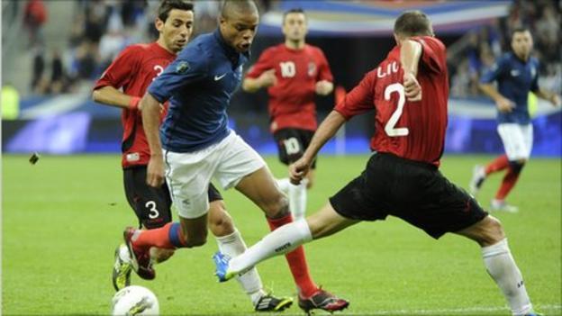 French forward Loic Remy (C) vies with Albania's defenders Kristi Vangjeli (L) and Andi Lila in les bleus' Euro 2012 clash