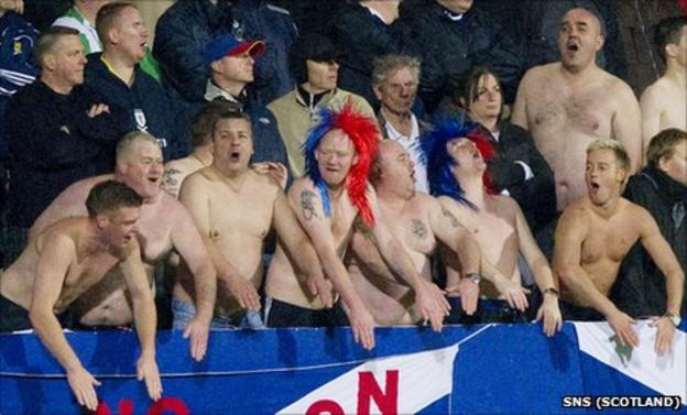 The Scotland fans cheer on their team in Liechtenstein