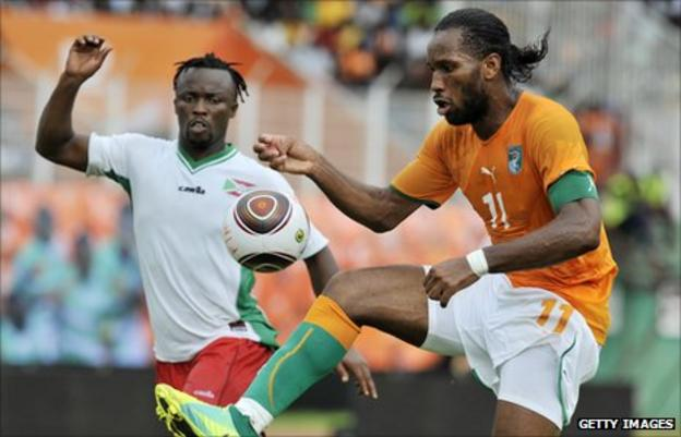 Didier Drogba challenges for the ball against Burundi