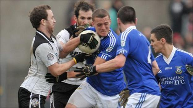 Dromore's Paddy Montague is tackled in the semi-final against Omagh