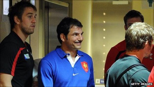 France coach Marc Lievremont comes across Wales players at their shared Auckland hotel