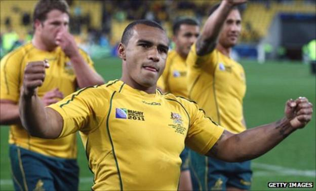 Australia scrum-half Will Genia celebrates victory over South Africa