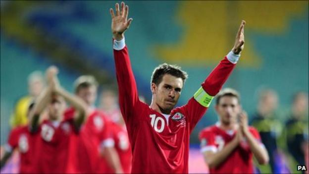 Wales captain Aaron Ramsey leads the celebrations in Sofia