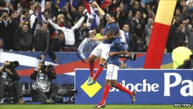 Samir Nasri and Loic Remy celebrate the former's goal in Paris