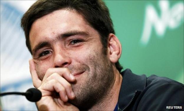 Dimitri Yachvili smiles as he speaks to the media on Wednesday