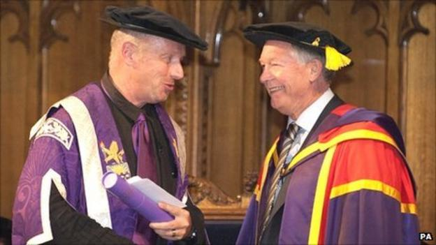 Manchester United manager Sir Alex Ferguson (right) receiving an honorary degree from The University of Manchester by University's Deputy President and Deputy Vice-Chancellor Professor Rod Coombs (left)