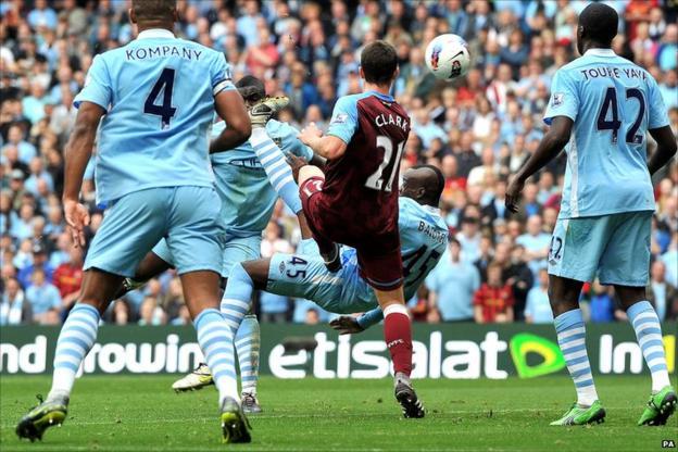 Mario Balotelli completes an overhead kick