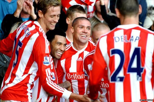 Jon Walters celebrates with Stoke teammates