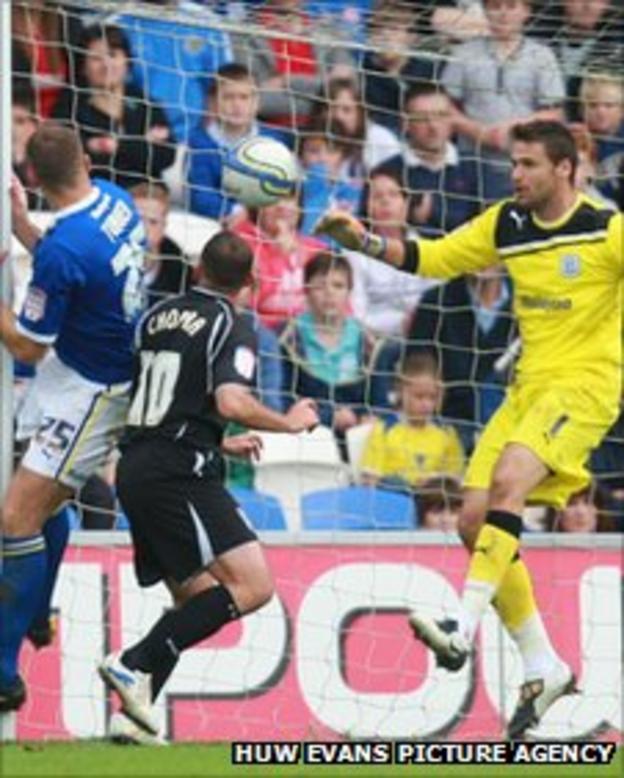 Ipswich striker Michael Chopra heads in at the far post