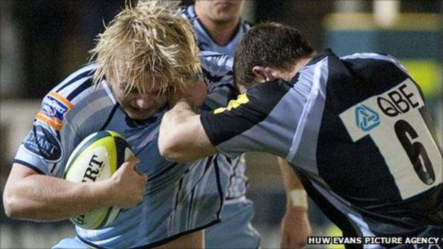 Cardiff Blues' Luke Hamilton is tackled by Mark Wilson of Newcastle